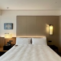 The Clan Hotel Deluxe Room bed